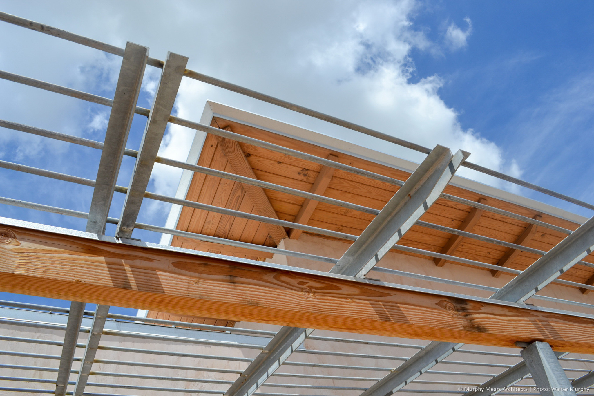 integration of galvanized steel with unfinished wood for shade and roof structrures