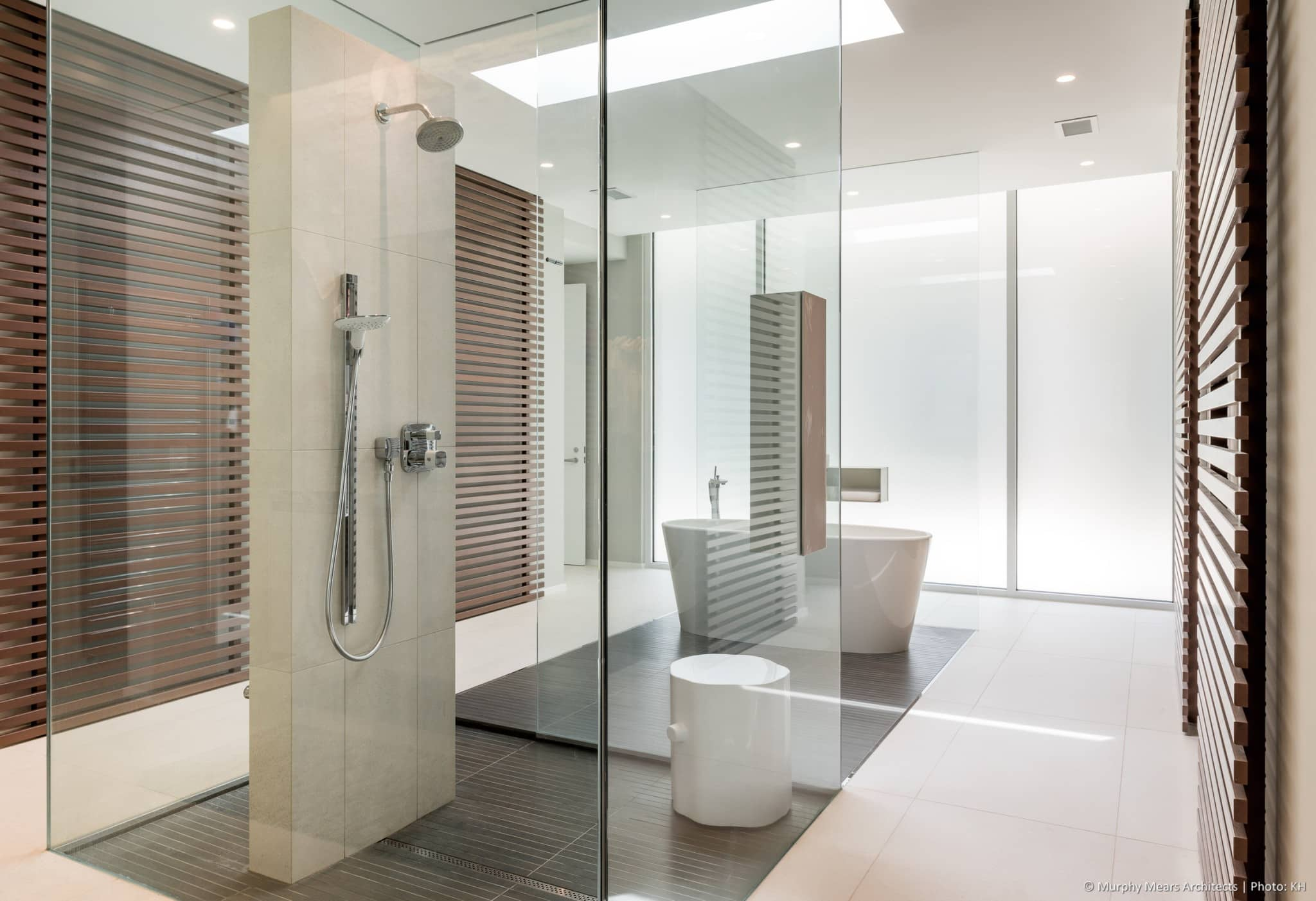 Centralized shower and tub in the master bath, with slatted rolling panels framing the cross-axis closet entries.