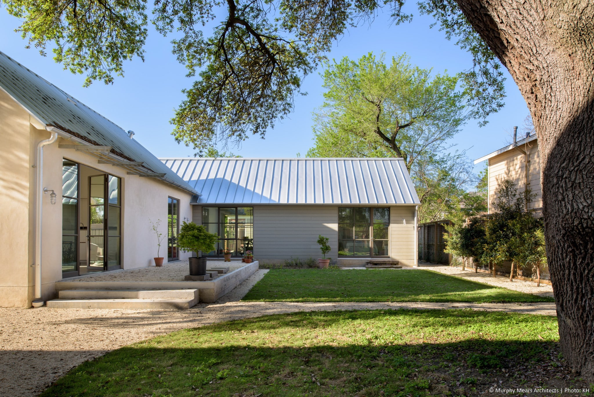 Sabine street cottages murphy mears architects for Metal roof ranch house