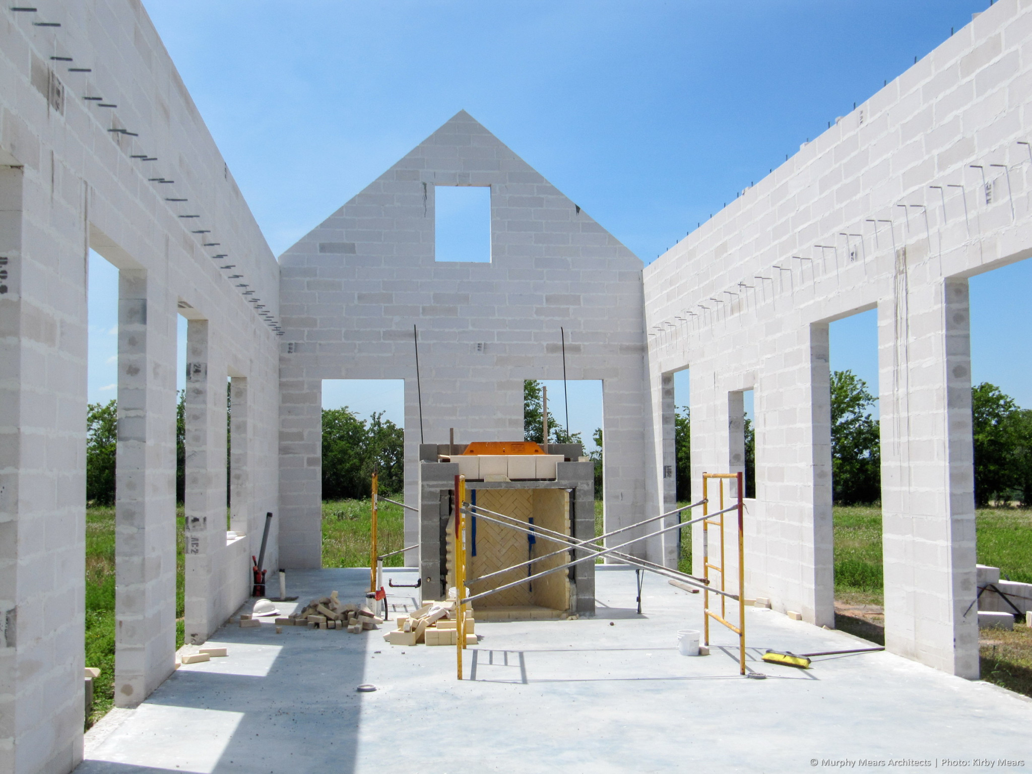 Completed AAC Block structural shell, with central fireplace under construction.