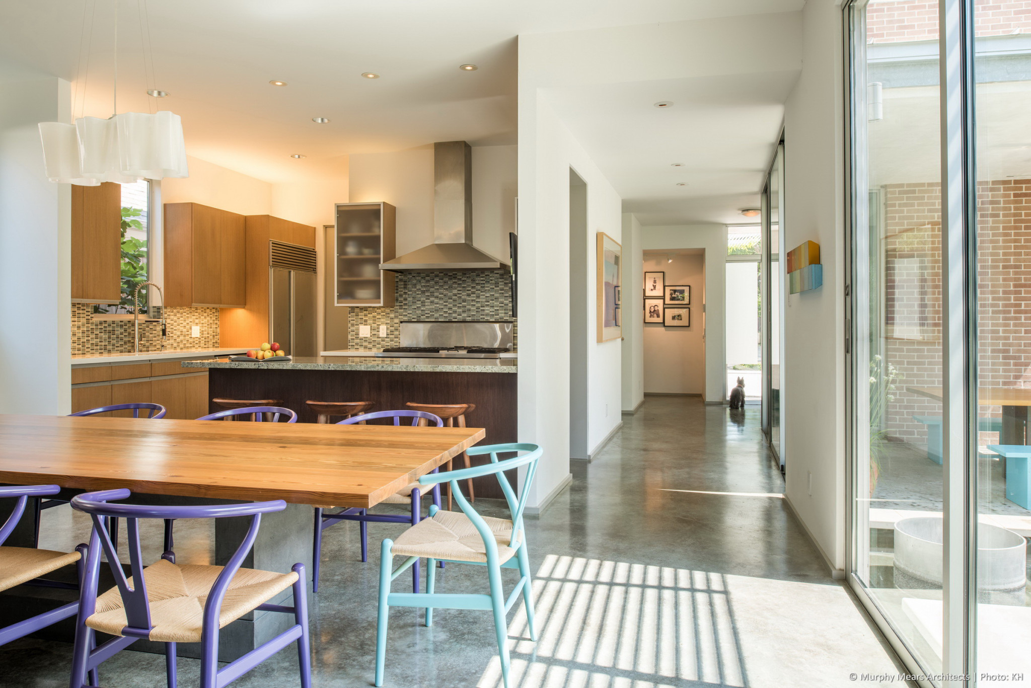 Central axis, shifted at entry hall, passes along East side of Kitchen and Dining Room.