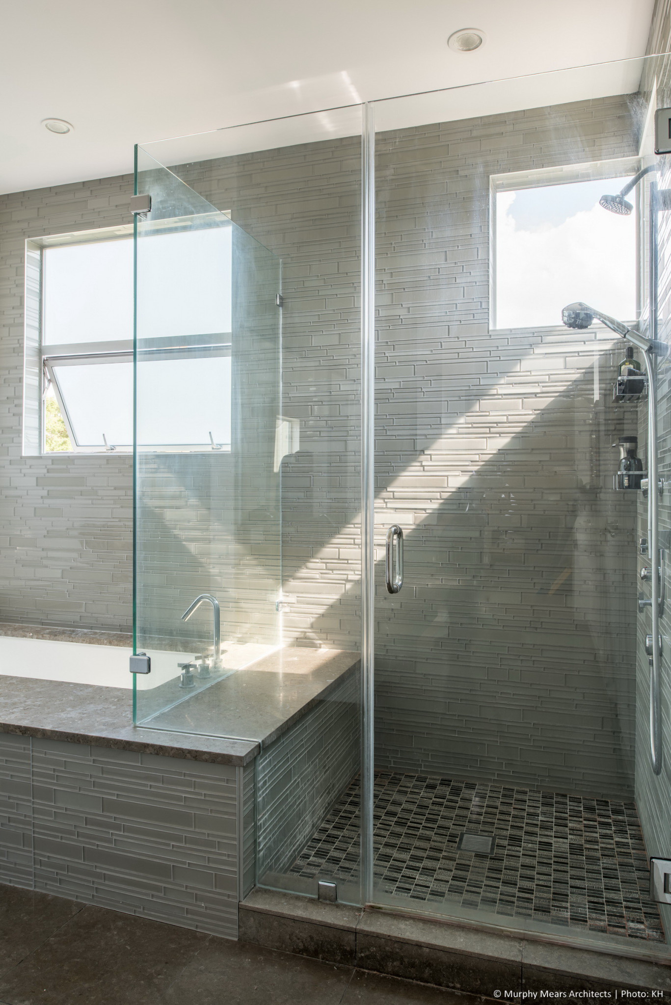 Natural light through the high corner windows over the master shower.