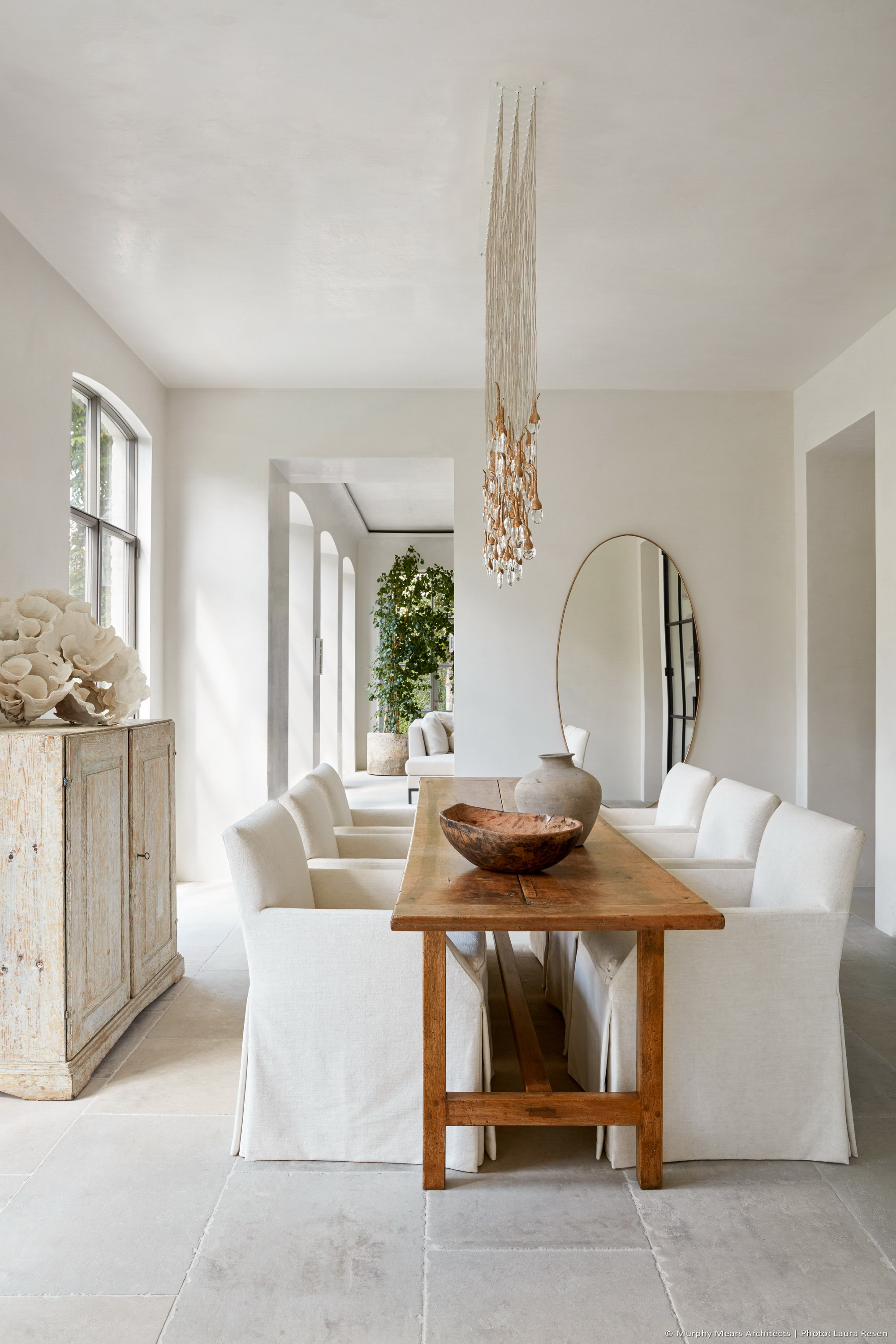 Centrally located dining room french limestone floors and plaster walls and ceiling.