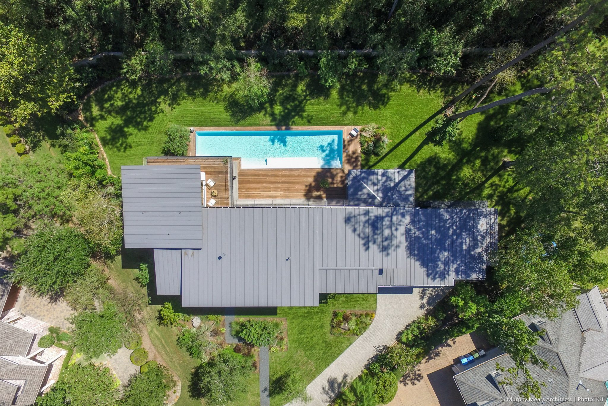 Open House - Standing seam metal roof, oriented south for solar panels.