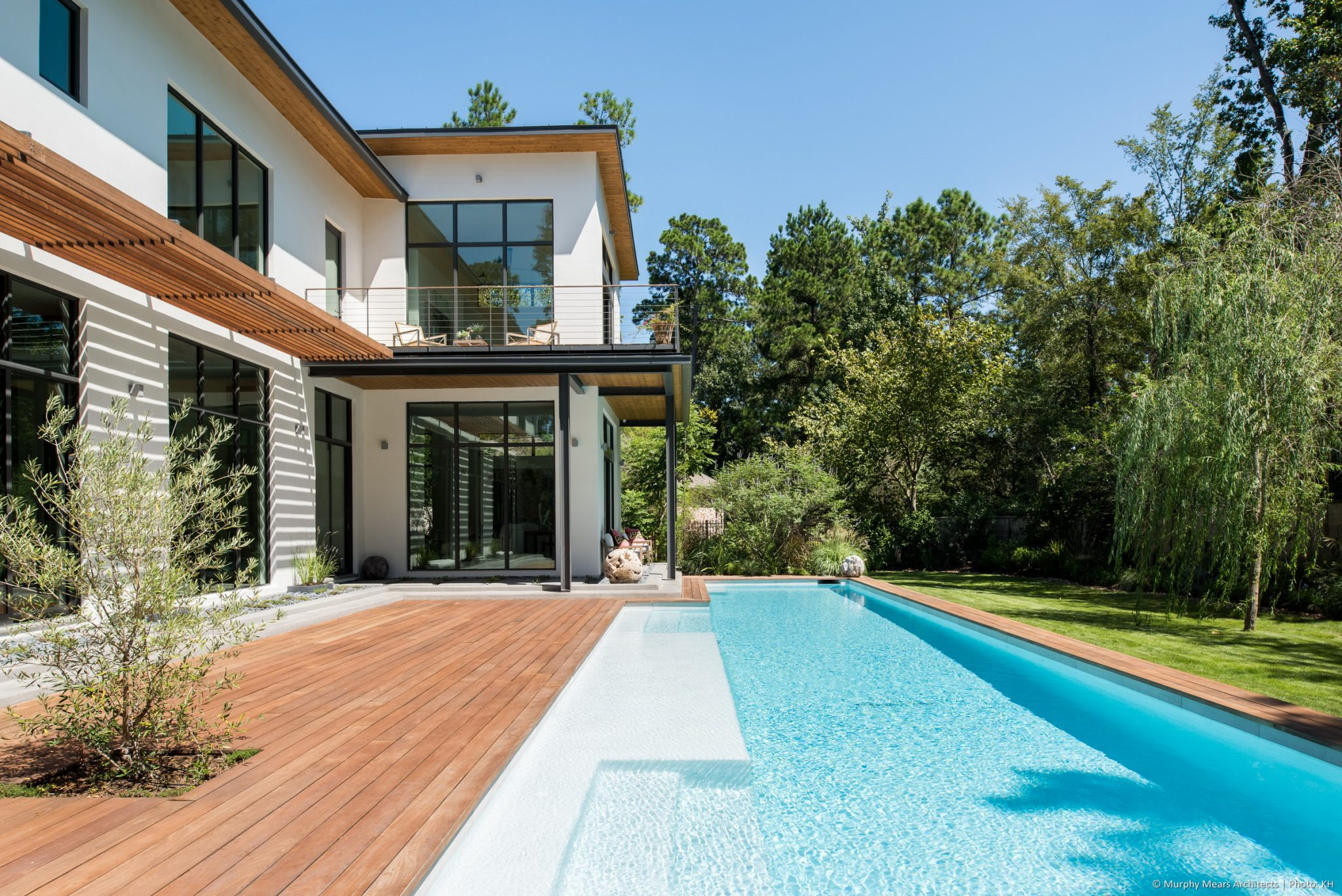 Open House - Wood deck, with an integrated drainage system below, bridging between the house and pool.