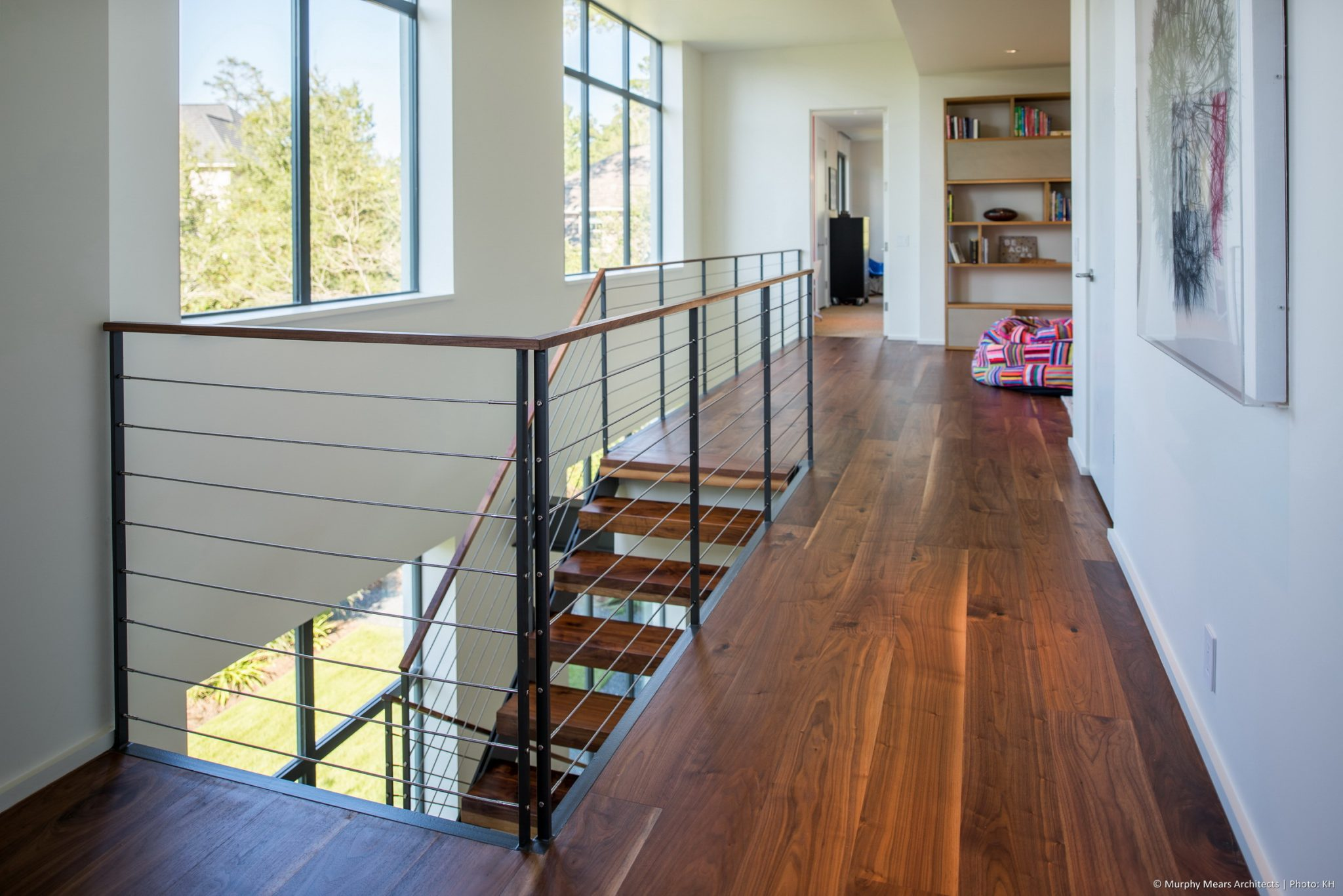 Carlton Woods Residence - The open stair arrives at a central second floor sitting room overlooking a two-story interior space along the front of the house.