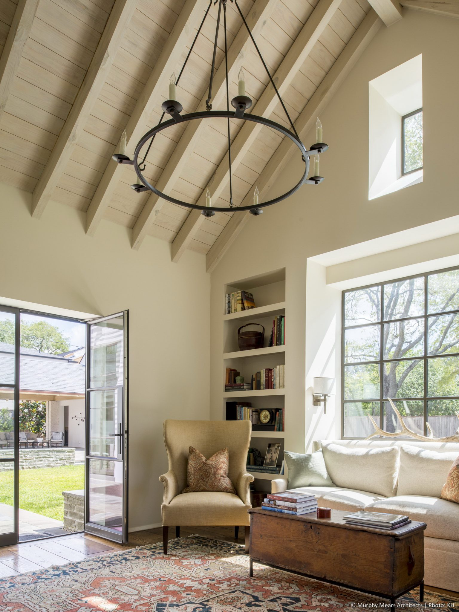 Courtyard House - 1-story vaulted study with windows and doors overlooking the central outdoor space.