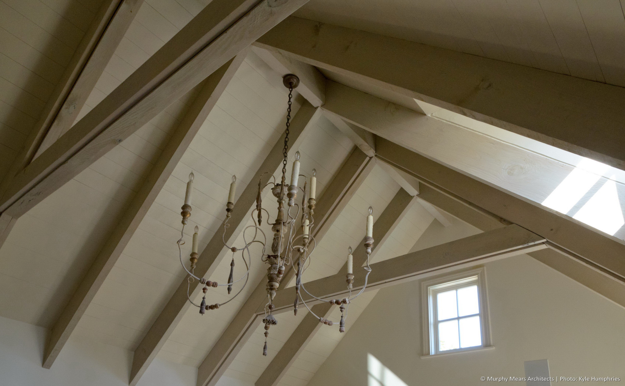 Pemberton Residence - Master bedroom ceiling trusses and beams with high natural light.