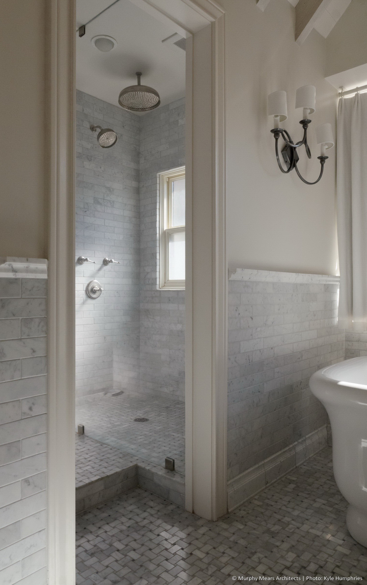 Pemberton Residence - Master shower with soft natural light filtered through a frosted glass south-facing window.