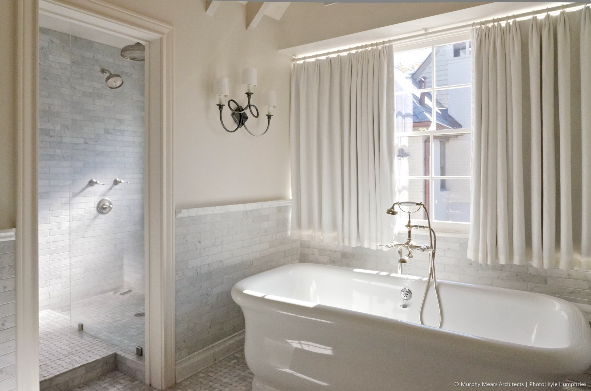 Pemberton Residence - New master bath with free-standing tub located beneath a south facing window.