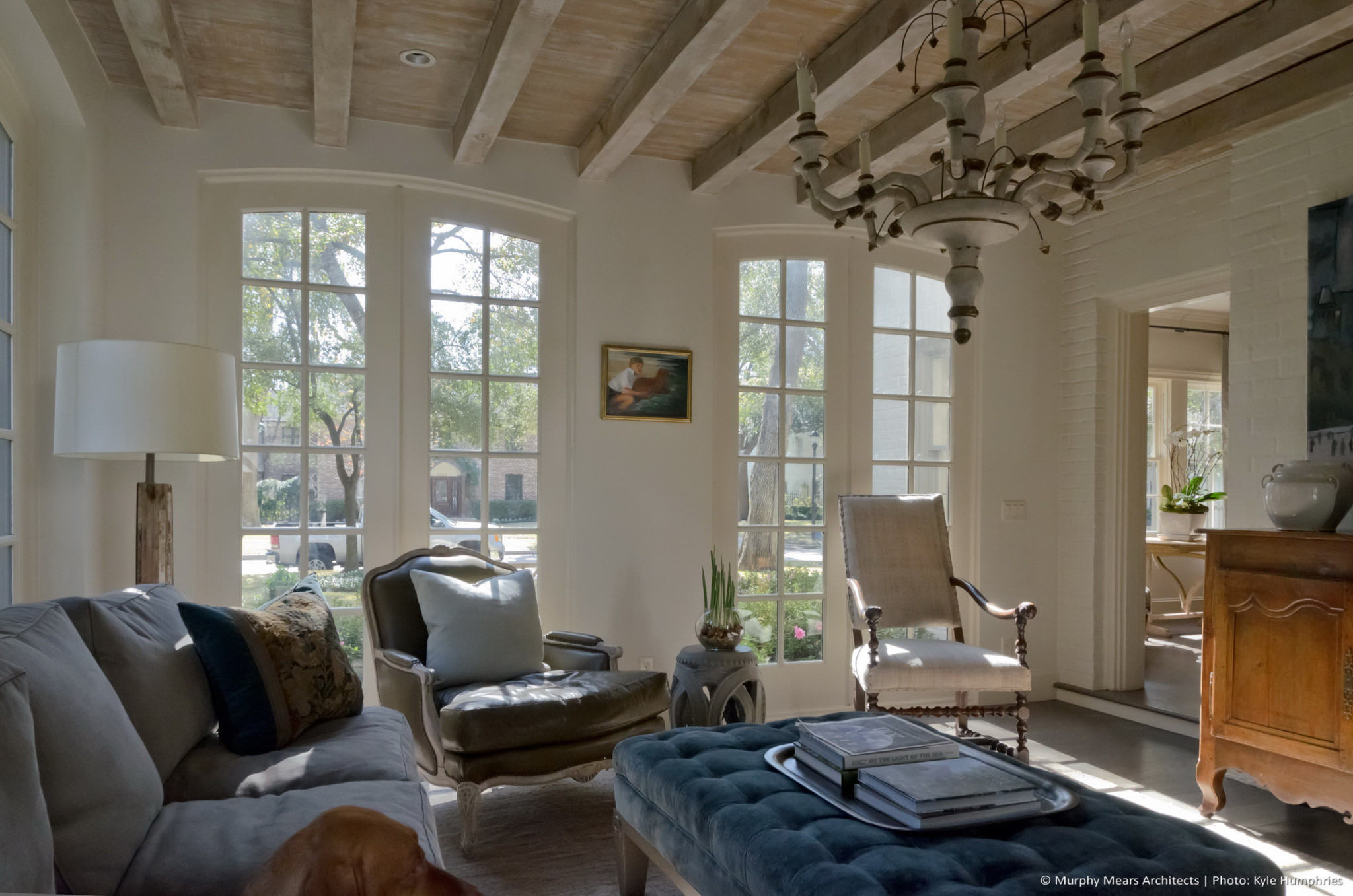 Pemberton Residence - New sitting room with exposed wood beams and ceiling supporting a second-floor addition above.