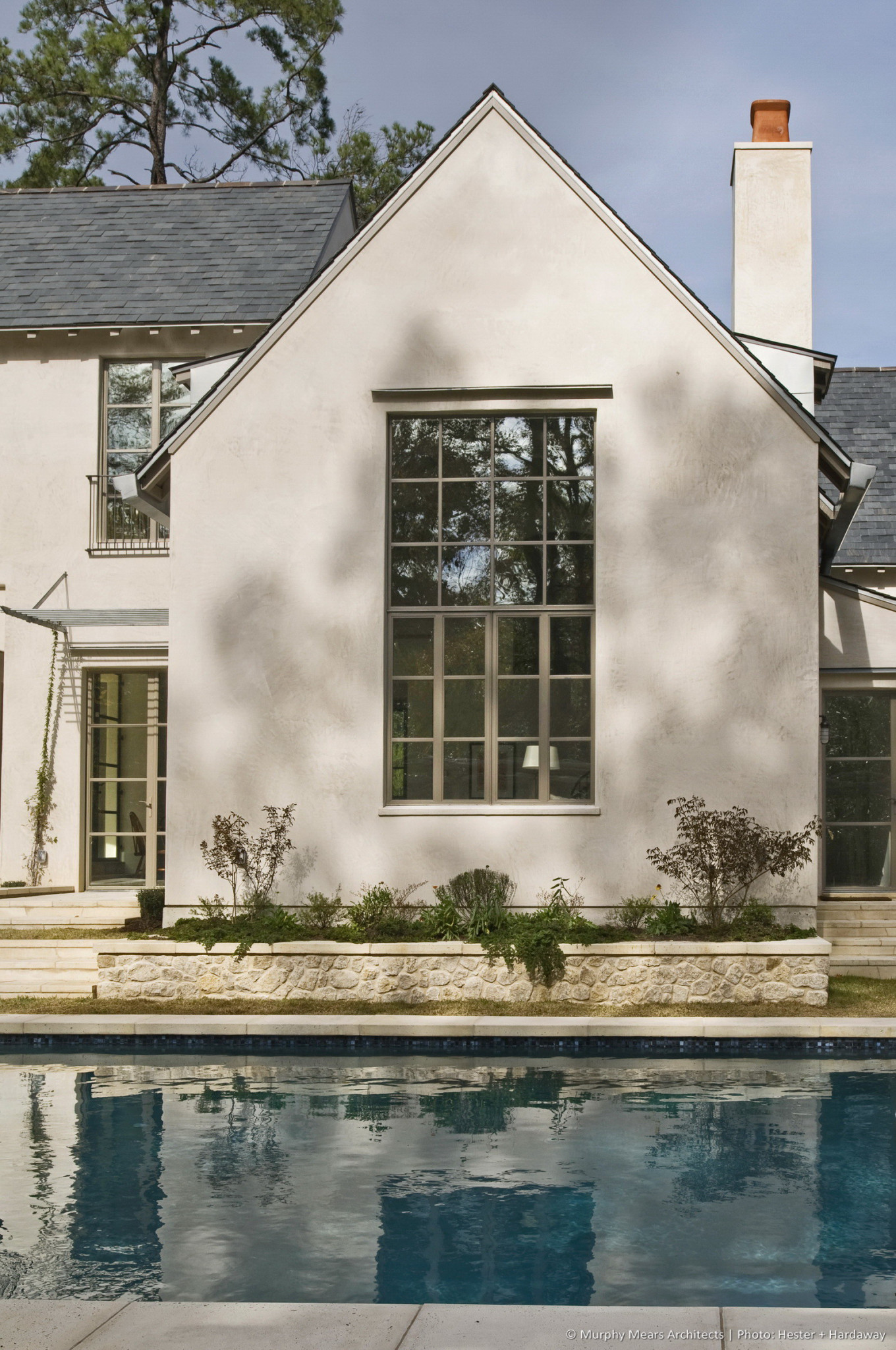 Lindenwood Residence - The large window in the Family Room overlooking the pool and backyard.