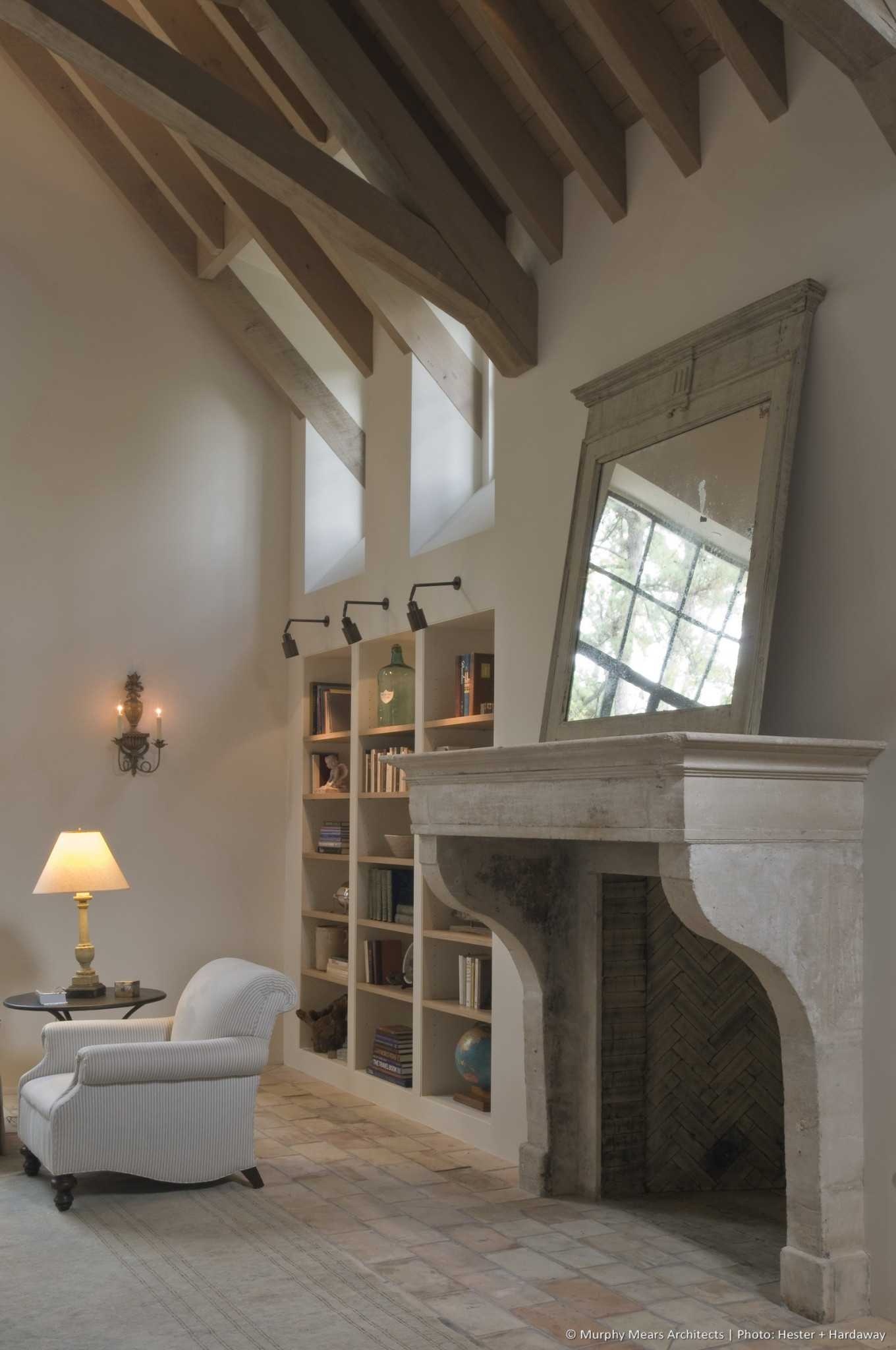 Lindenwood Residence - Large antique fireplace surround in the Living Room, located between bookshelves and dormer windows on each side.