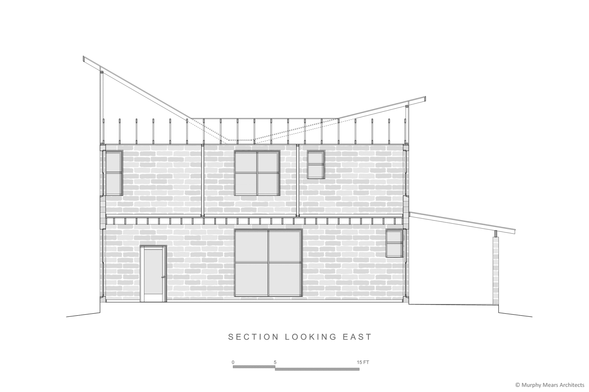 Section through open living-dining-kitchen on 1st floor with bedrooms above.