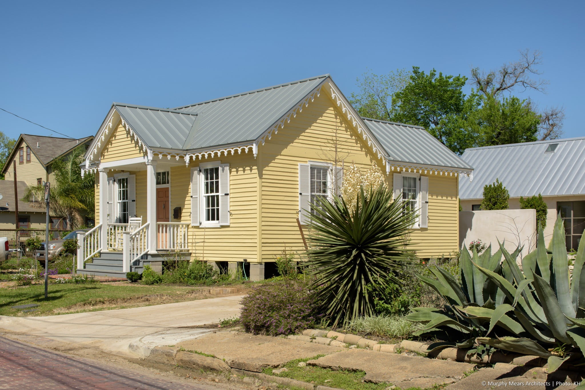 Restored exterior of the 1870's Gottlieb Eisele house, with a similar roof line on the new cottage visible beyond.