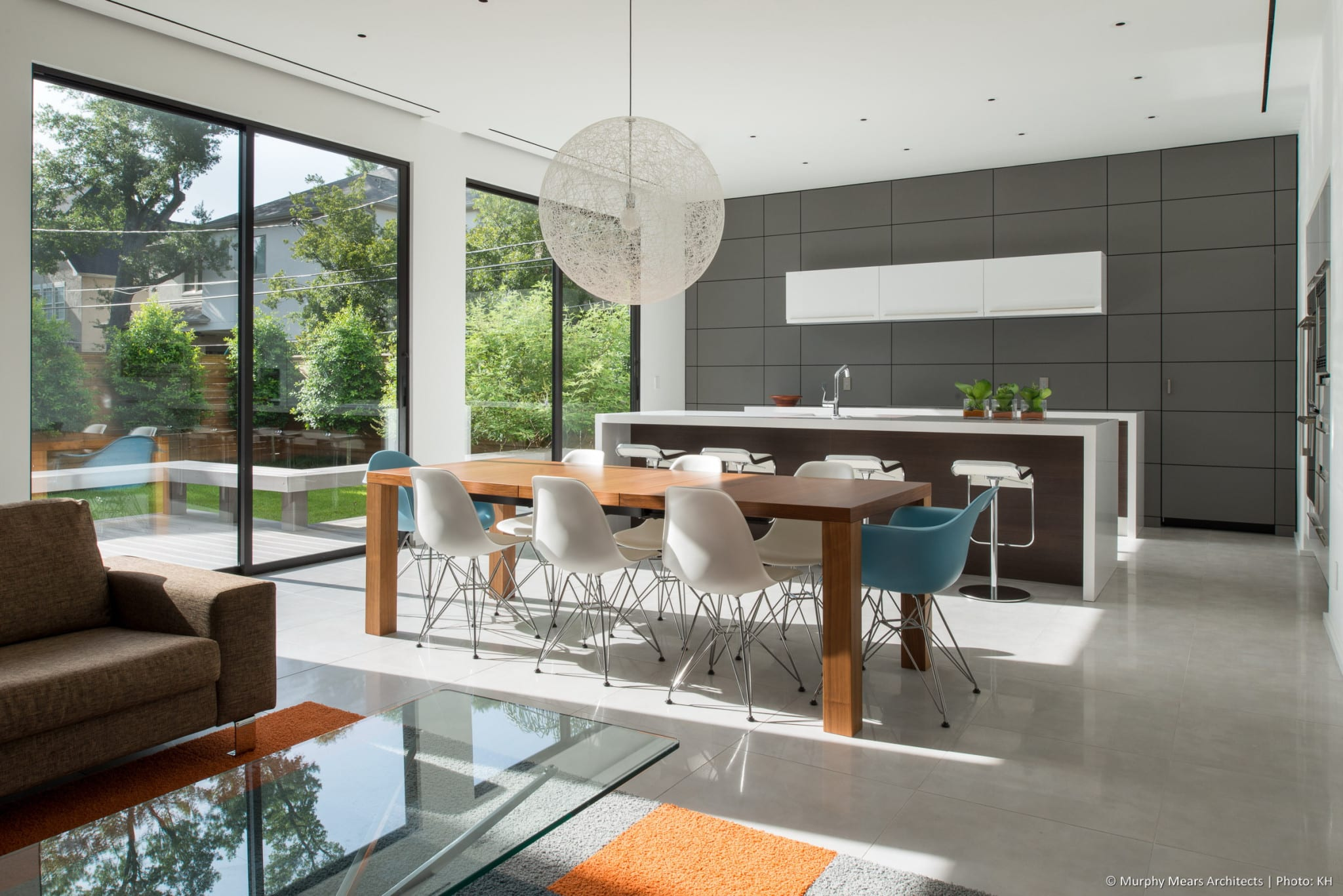 Open living-dining-kitchen with direct connections to the large back courtyard.