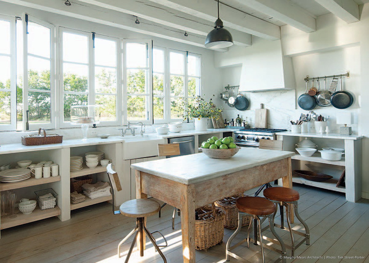 French casement windows in the kitchen, overlooking the main drive towards the house.