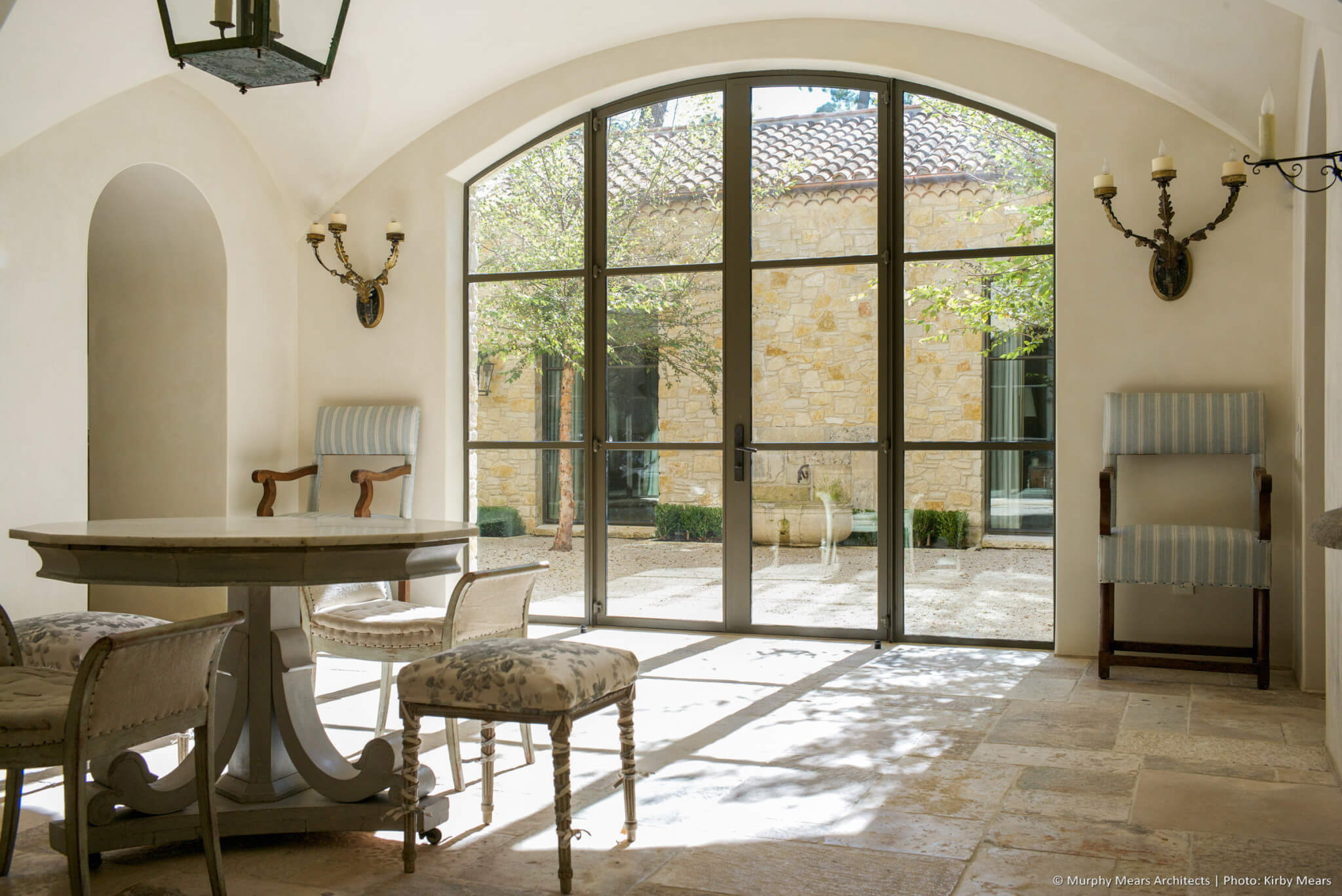 Front entry hall with random versaillles pattern reclaimed stone floor, and interior courtyard beyond.