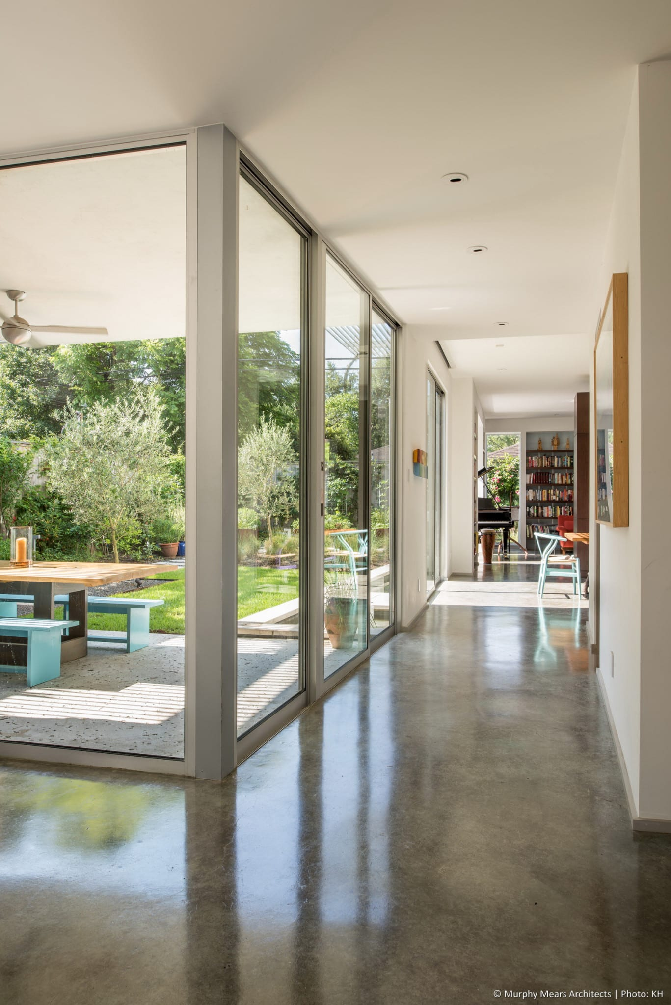 Entry hall with slightly shifted axis leading through kitchen, dining and living spaces.