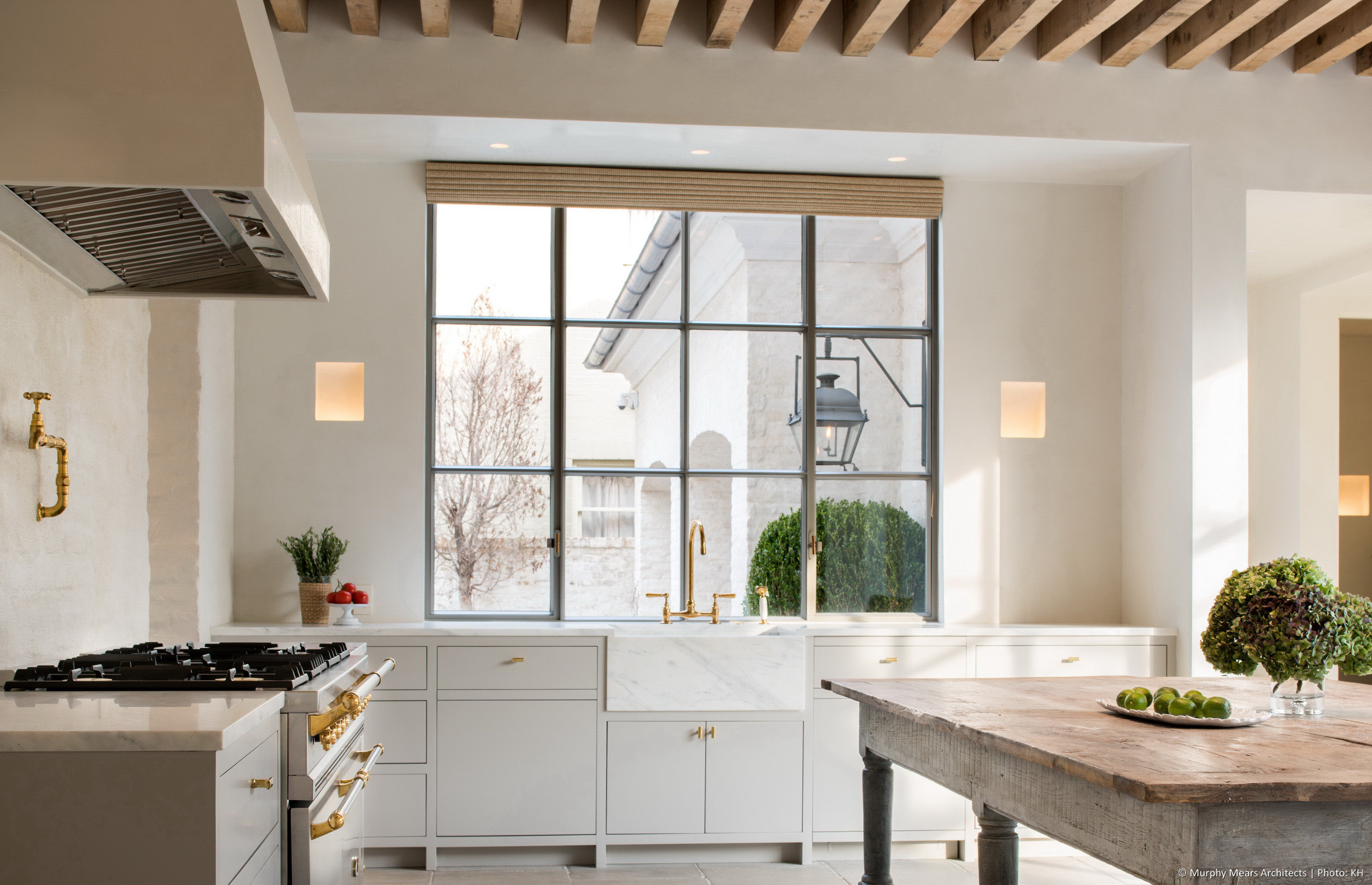 Marble farmhouse sink in front of the steel kitchen window, overlooking the side autocourt.