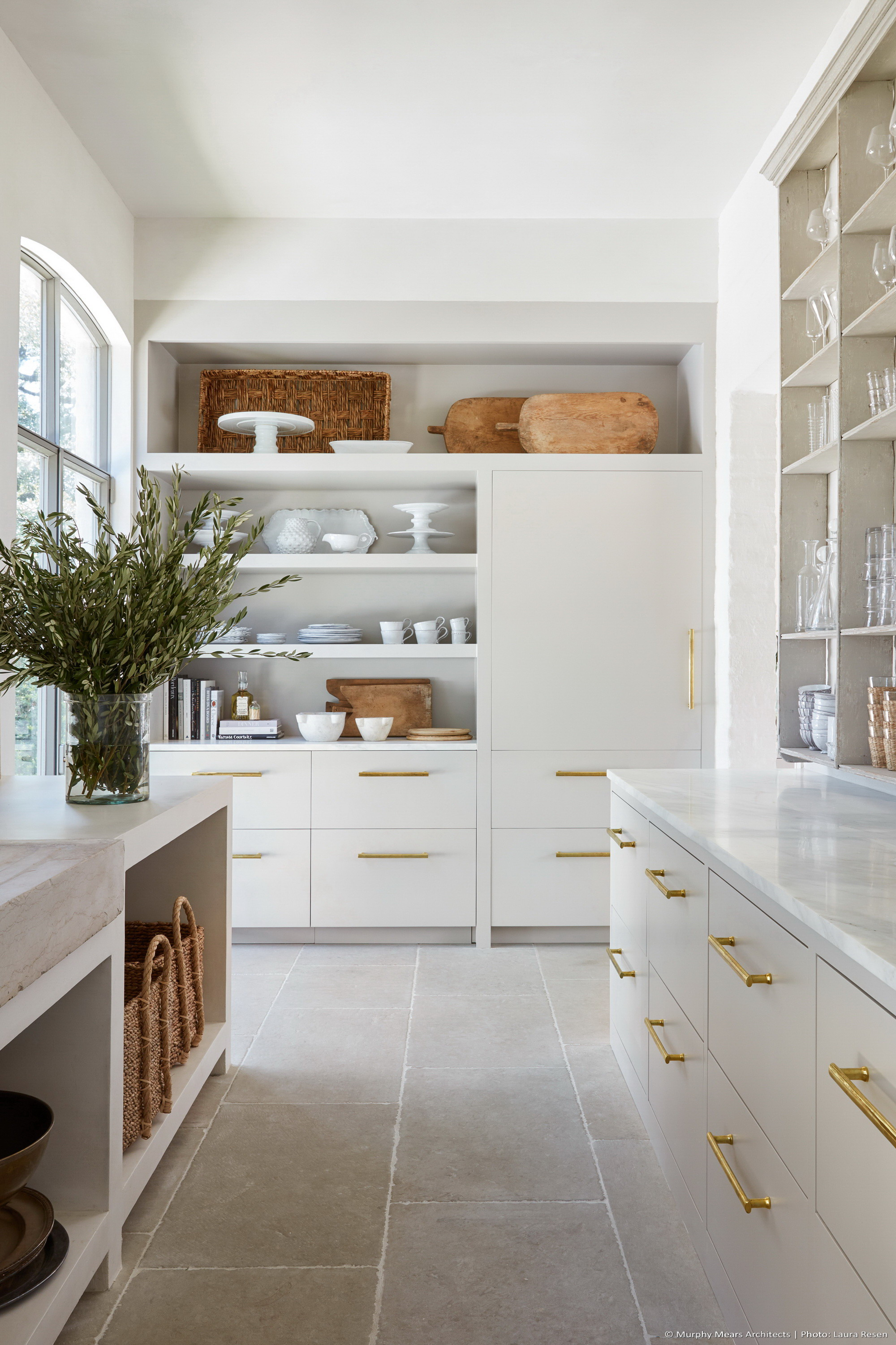 Scullery off the main kitchen, with storage, prep and cleaning areas.