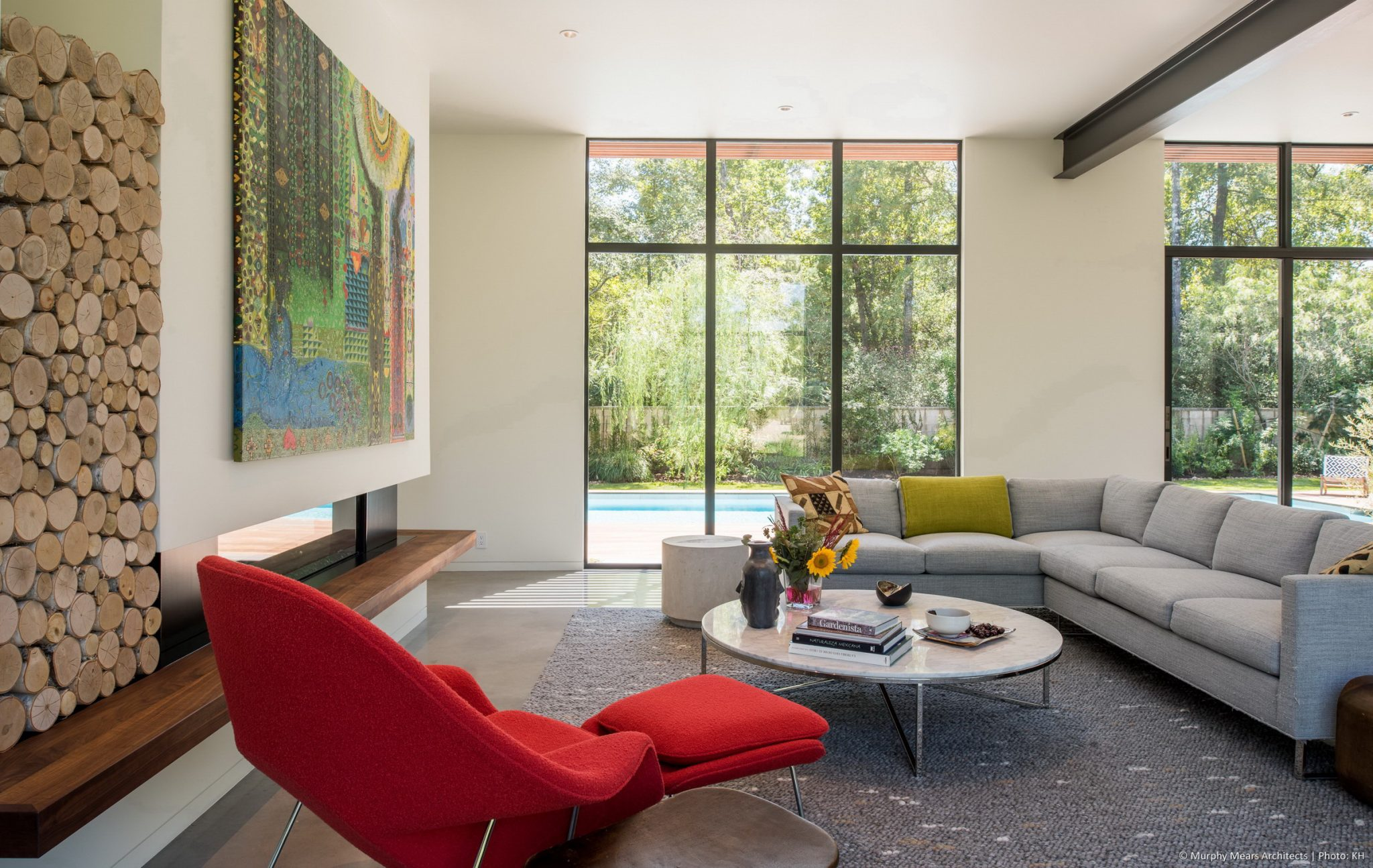 Carlton Woods Residence - A structural steel beam provides a line of separation between living and dining spaces in the open first floor plan.
