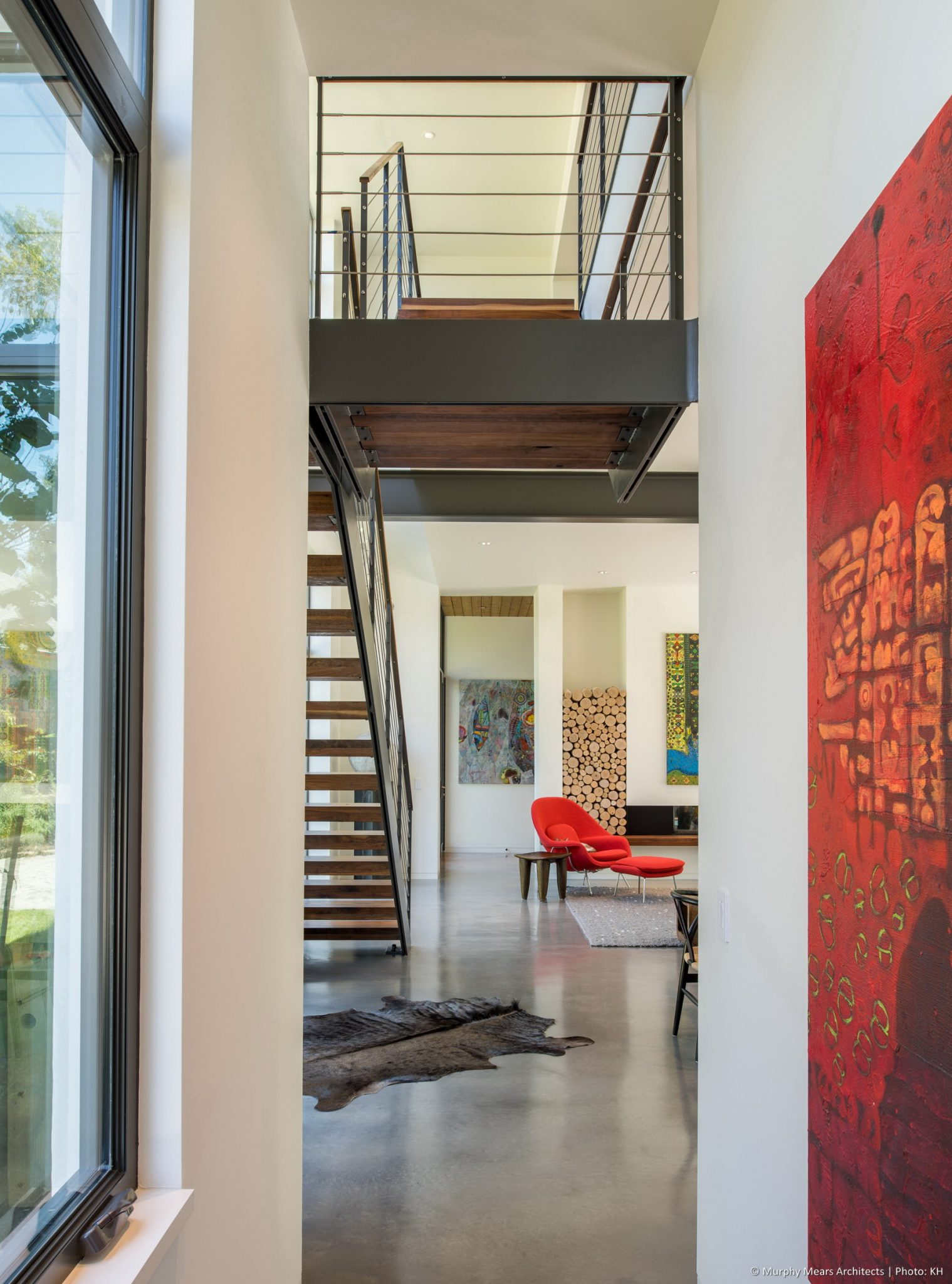 Carlton Woods Residence - Arriving in the open dining-living area form the mud room hall, beneath the floating steel and wood stair landing.